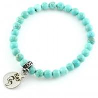 Armband van turquoise kralen met fotobedel